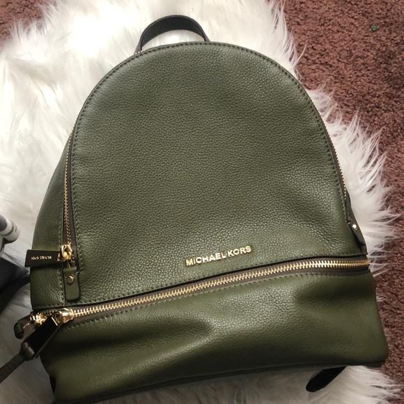 93a555bcfc5bd8 Olive green Michael Kors backpack. M_5a5cdf6ca44dbe9cb533db12